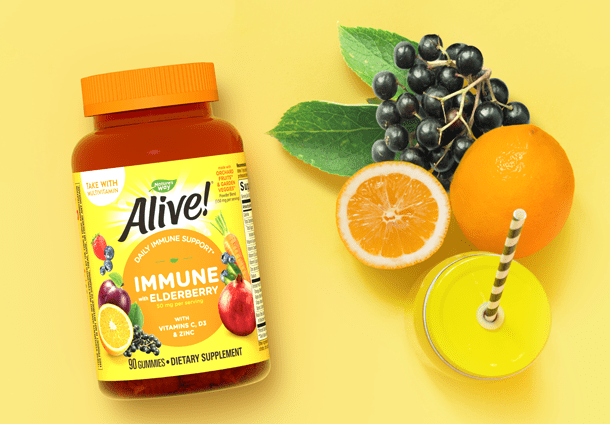 Alive Immune Guumies with Orange, Elderberry, and a Yellow Drinking Glass